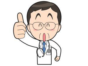 親指を立てるサインを出す医師