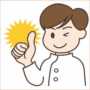 親指を立てるマッサージ師