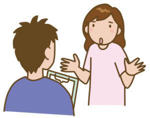 整体師に話す女性