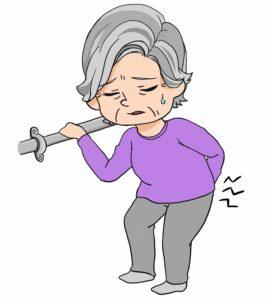 腰痛で手すりを握るおばあさん