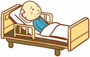 介護用ベッドに横になっているおじいさん