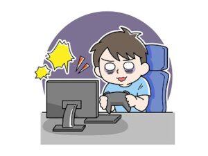 パソコンのゲームに熱中する子供