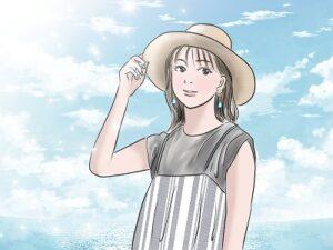 日光を浴びる麦わら帽子の女性